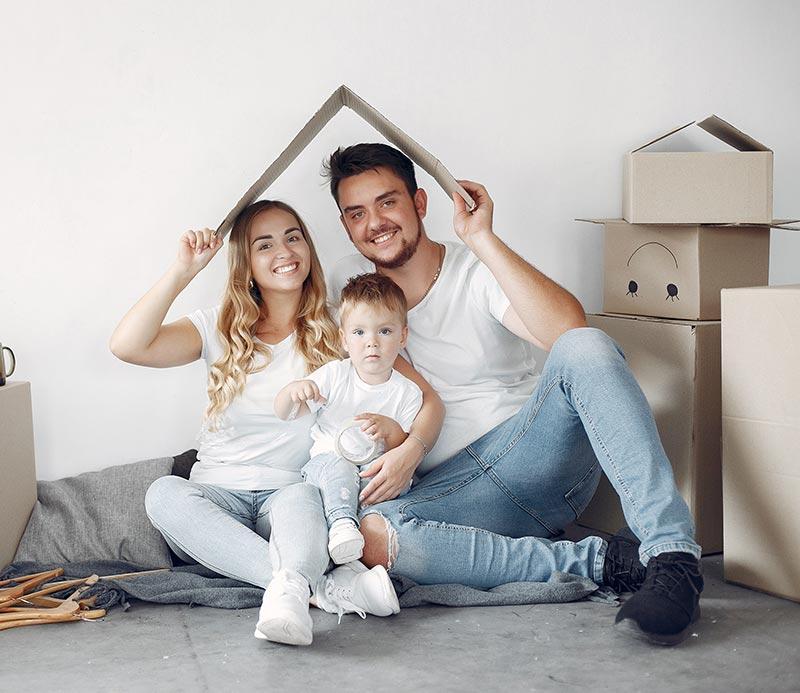 Happy-family-sitting-on-floor Family Dentist Oshawa
